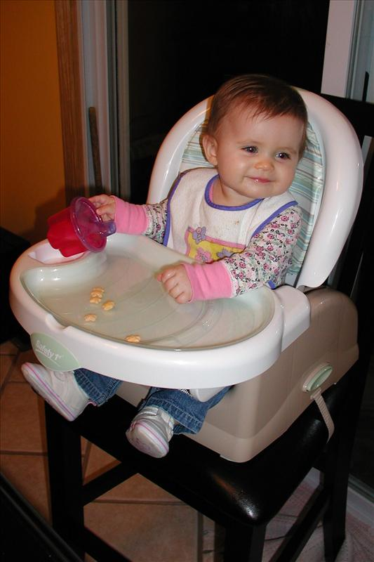 Molly trying out her high chair
