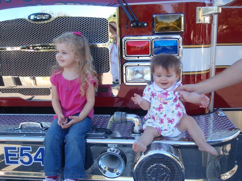 Both girls on the fire truck