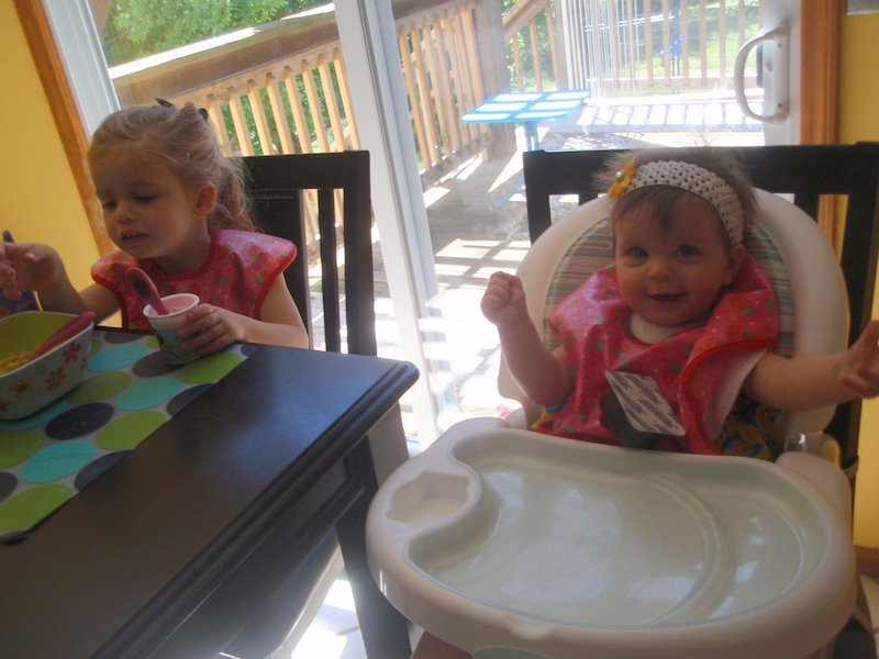 Eating dinner in matching bibs ... how cute!