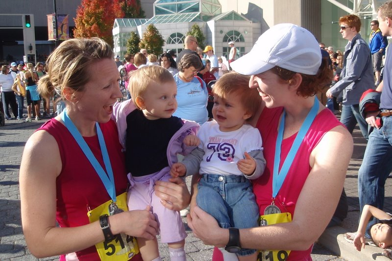 Charlotte and Ella congratulating their mom's on finishing the half marathon