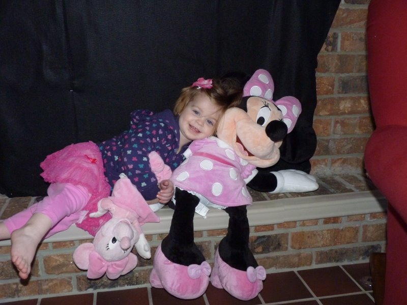 Charlotte's new thing, sitting with Minnie for pictures.