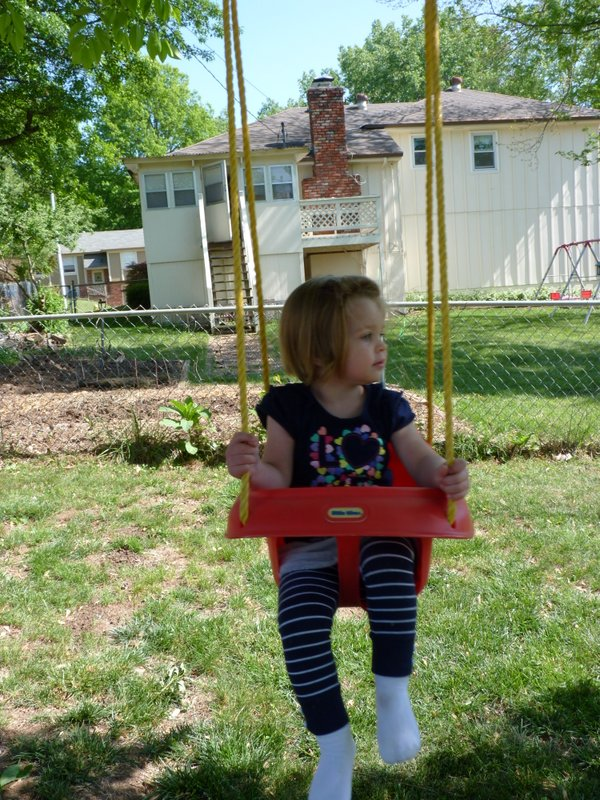 Get this girl a swing and she's happy!