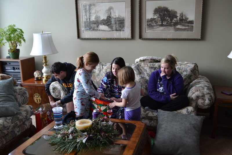 Helping Aunt Amber open her present