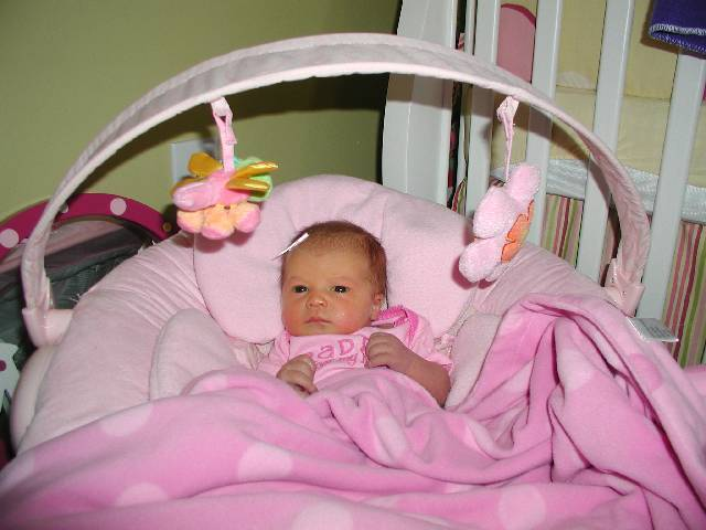 Molly tries out the bouncy seat.
