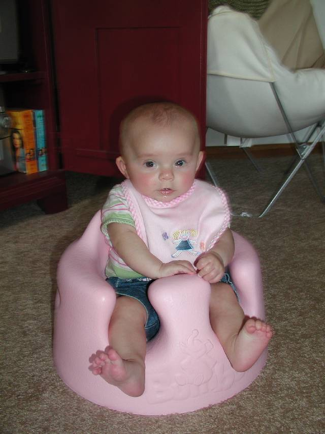 Chloe tries out Molly's Bumbo to make sure that it works.